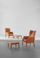 Mogens Koch, Pair of Wingback Armchairs and Ottomans.