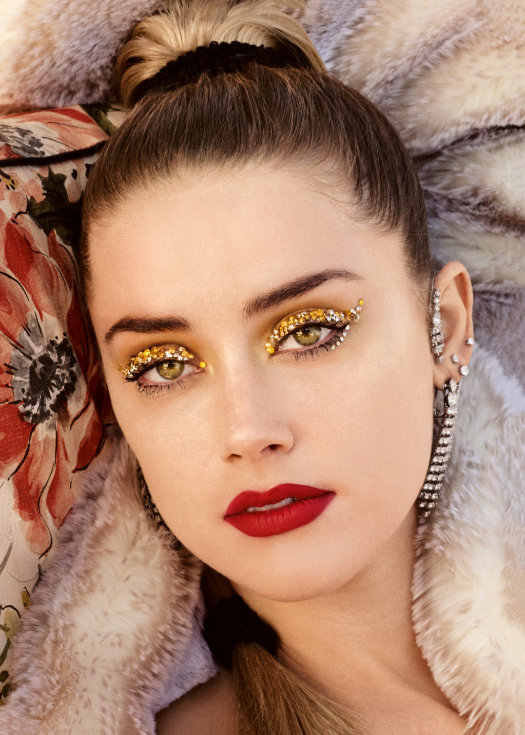An artificial fur jacket, Norma Kamali; metallic earrings with rhinestones, New York Vintage. Tone cream Even Better Makeup Broad Spectrum SPF 15, Neutral; Eyebrow Gel Just Browsing Brush-On Styling Mousse, Blonde; lip liner Pop Matte Lip Color + Primer, Candied Apple Pop, all Clinique.