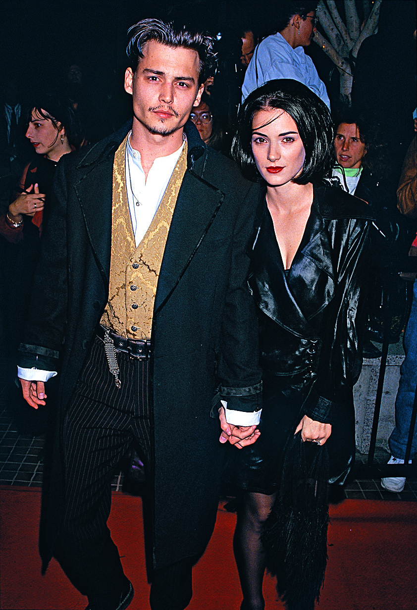With her friend, actress Winona Ryder at the premiere of Edward Scissorhands, 1990.