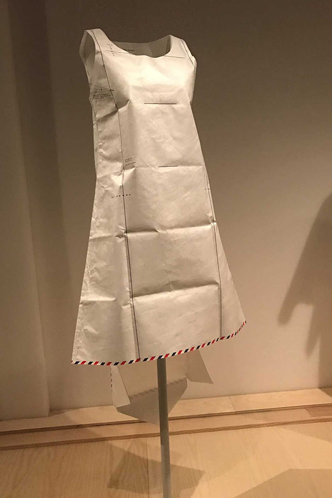 Dress (1999) in white Tyvek printed with red and blue diagonal stripes, by Hussein Chalayan (British, born Cyprus, 1970).