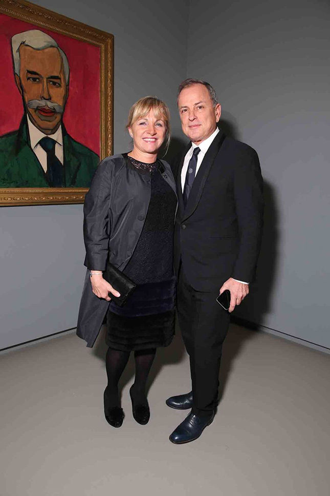 Michael Burke, Chairman and CEO of Louis Vuitton, with Brigitte Burke, in front of Christian Cornelius Krohn's portrait of the collector of these masterpieces, Sergei Shchukin (1915)