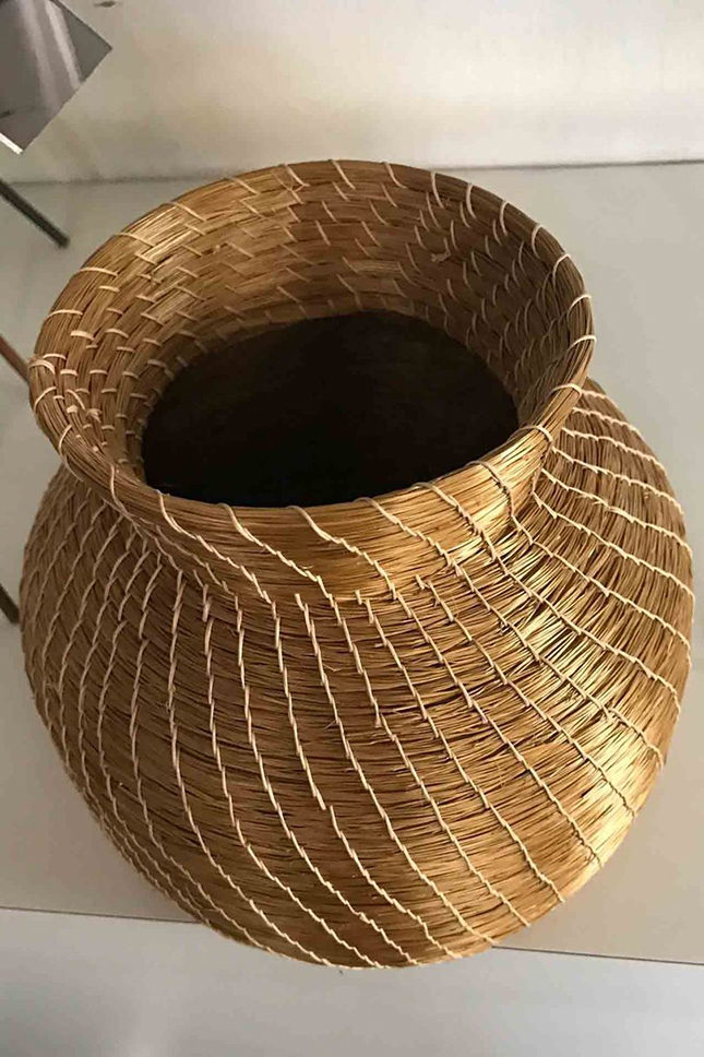 It may look gilded, but this Campana basket is made from pure straw