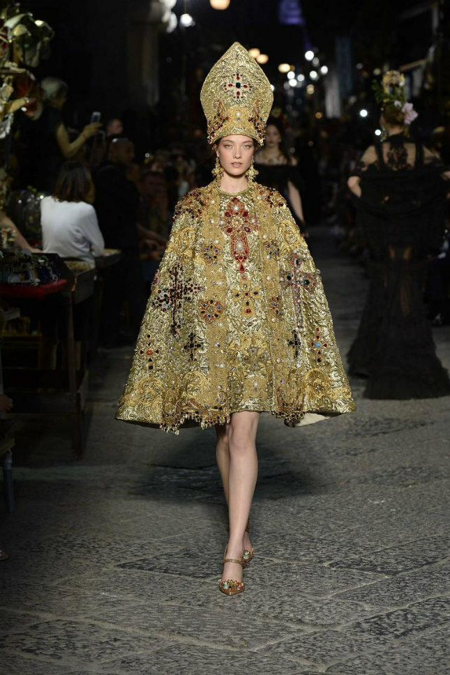 The collection featured Catholic religious influences like a brocade cape with a papal pointed cap
