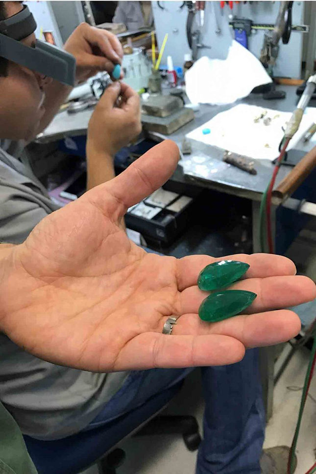 Ara shows Suzy two prized pear-shaped emeralds in his São Paolo studio