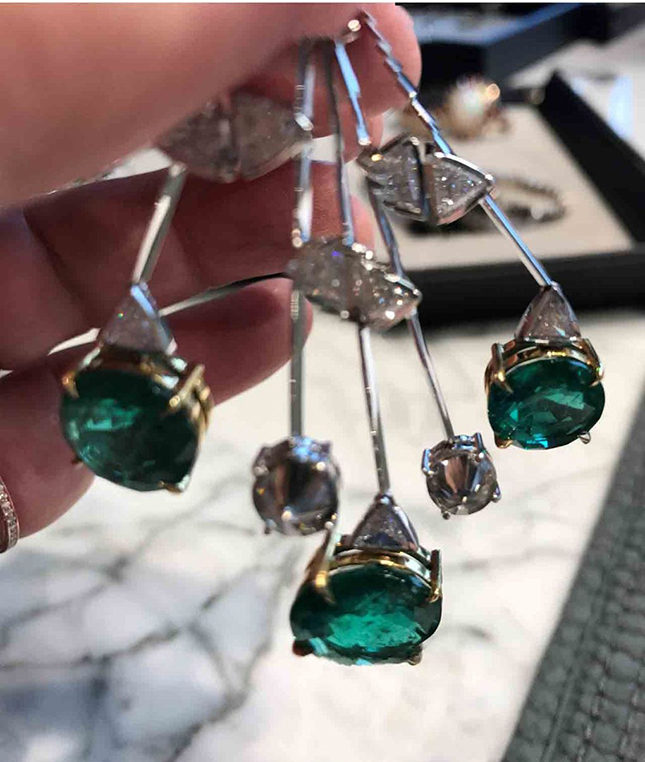 Suzy plays with the diamond, white gold and emerald