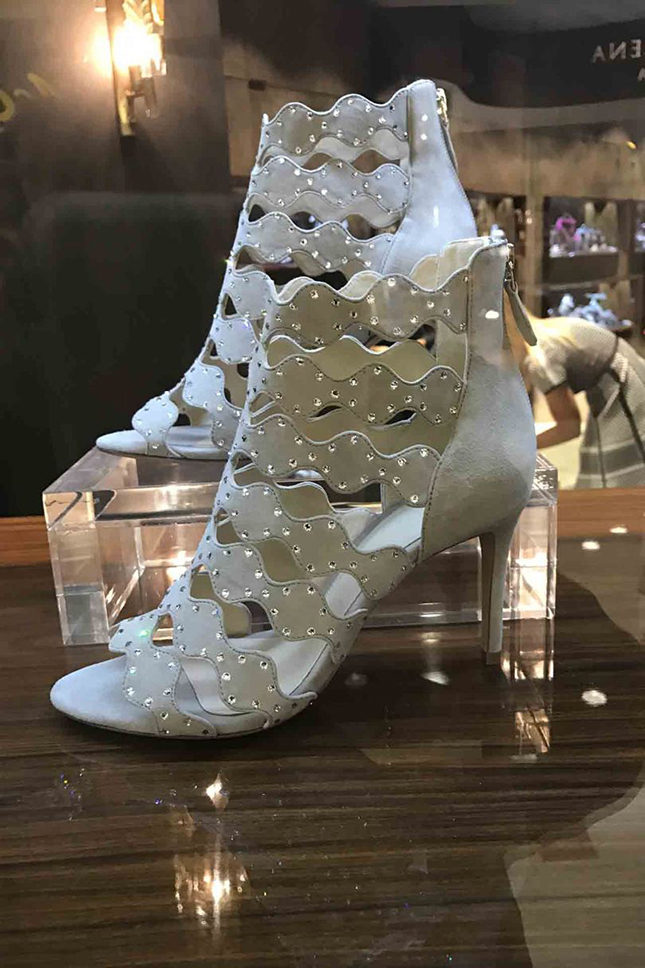 Alexandre Birman gladiator ankle boots, made from laser-cut suede with crystal embellishment