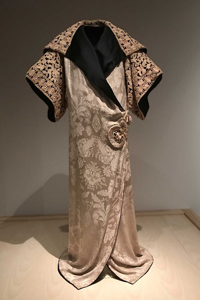Opera coat (1911) by Paul Poiret (French, 1879-1944) for his Haute Couture collection, made from ivory silk damask with black silk crepe-back satin and ivory silk corded passementerie. Alfred Z. Solomon-Janet A. Sloane Endowment Fund 2008