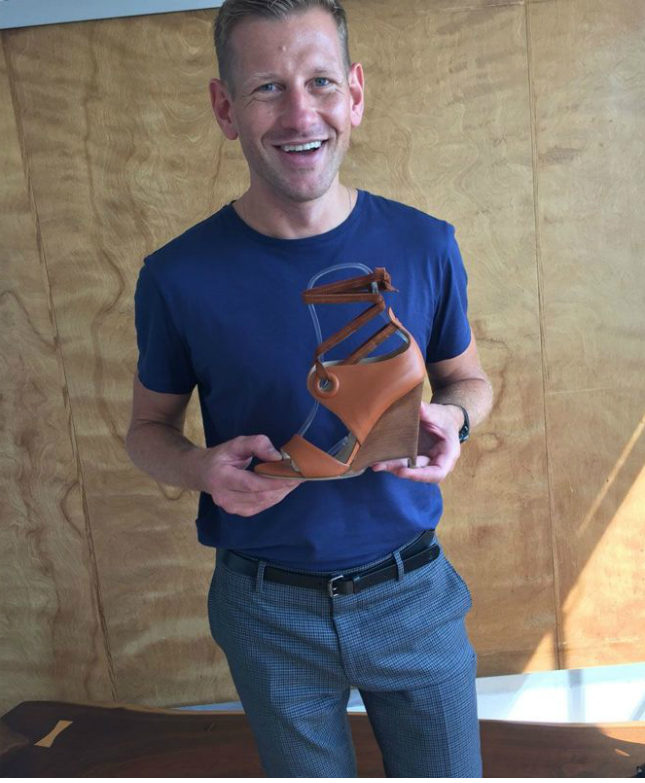 Paul Andrew in his New York showroom, with one of his signature wedge sandals for Spring/Summer 2017