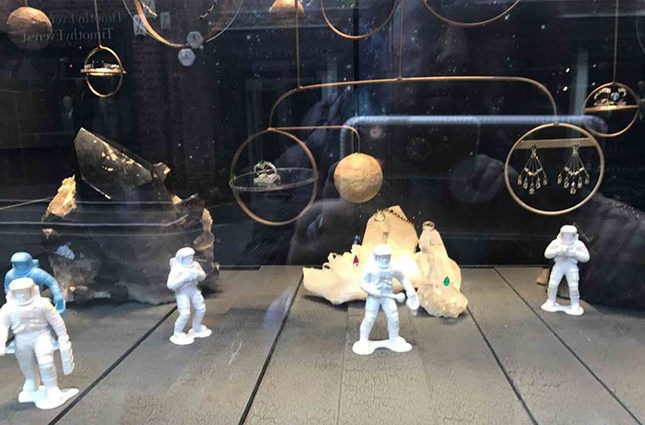 The window display of Ara's London boutique on Bruton Street features astronaut figurines exploring a cosmos of rock crystal and high jewellery