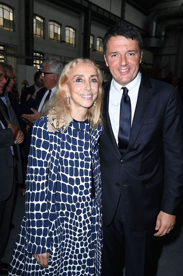 Franca Sozzani, Editor-in-Chief of Vogue Italia, with the Italian Prime Minister, Matteo Renzi, at the official launch of Milan Fashion Week, Spring/Summer 2017