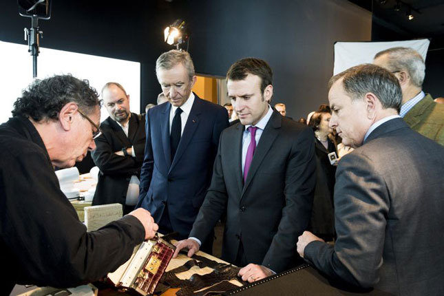 French President Emmanuel Macron with Bernard Arnault, CEO of LVMH, at a Louis Vuitton exhibition