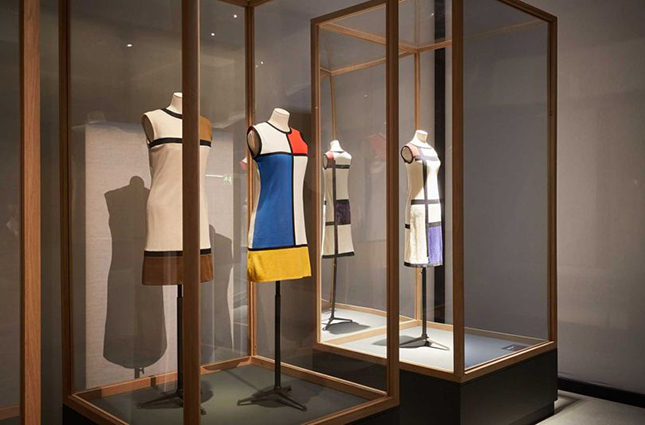 Yves Saint Laurent was inspired by Piet Mondrian for this ground-breaking shift dress in the Sixties (centre)