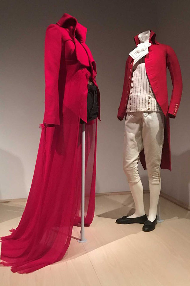 Left: Ensemble for Spring/Summer 2015 by John Galliano (British, born Gibraltar, 1960) for Maison Margiela Artisanal (French, founded 1988). Coat made from red brushed wool needle-felted with red silk chiffon trimmed with red rayon velvet; worn over a top of black nylon net, embroidered with gold metallic thread and gold plastic sequins; worn with briefs in black polyester rib-knit embroidered with gold metallic thread, gold plastic sequins, and gold glass bugle beads and shorts in black cotton denim. Purchase, Friends of The Costume Institute Gifts, 2015