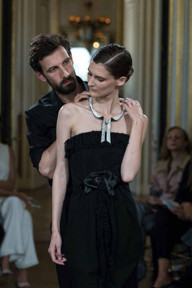 A model receives Boucheron's Plissée Diamants necklace, which replicates a scarf in white diamonds and jet black spinels