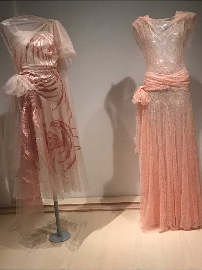 Left: Evening Dress (1929) by Madeleine Vionnet (French, 1876-1975) for her Haute Couture collection. Made from pink silk tulle, embroidered with pink rayon floss; worn over a pink silk gauze and crepe de chine slip. Purchase, Friends of the Costume Institute gifts, 2009