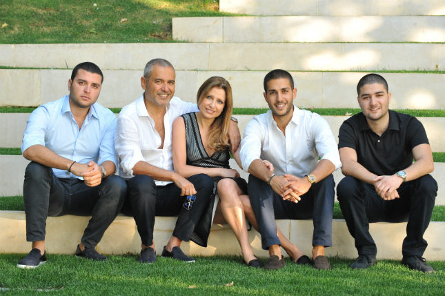 Elie Saab (second from left), with his wife Claudine and children Elie Jr. (left), Celio (in white) and Michel