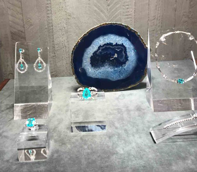 In the London store, a slice of blue crystal offsets the translucent tourmaline and diamond jewels